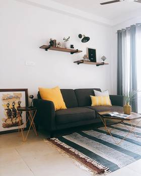 Friday throwback to the bachelor pad! Sofa Bed, Coffee - Side Table Set along with the wall shelves brings up the mood here  !! :)